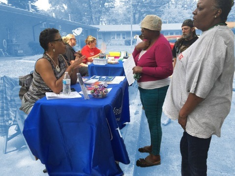 Sign up event for residents outside, sign up tables with staff to assist