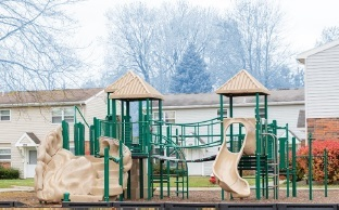 Elmdale Court Playground, green and tan with slide in community